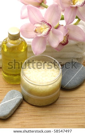 bowl of sea salt and stone with orchid