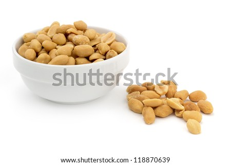 bowl of shelled peanuts on white background - stock photo