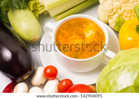 Bowl of Soup with Fresh Vegetables around