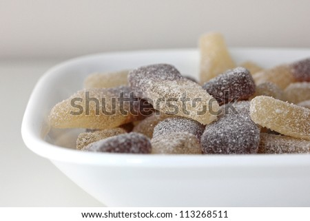 bowl of sour gummy cola candies - stock photo