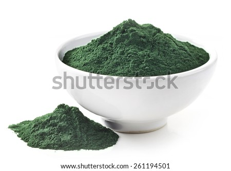 bowl of spirulina algae powder isolated on white - stock photo