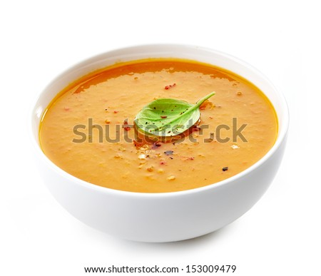 Bowl of squash soup isolated on a white background - stock photo