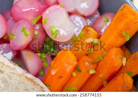 bowl of steamed root vegetable on a rustic white wood table - stock photo
