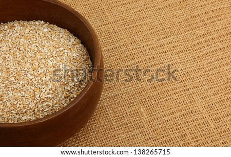 Bowl Of Steel Cut Irish Oatmeal On A Burlap Bag - stock photo