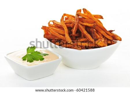 Bowl of sweet potato or yam fries with dipping sauce - stock photo