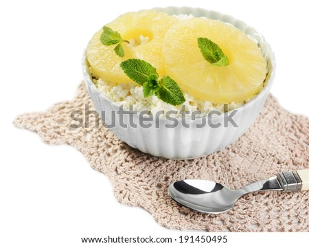 Bowl of tasty cottage cheese with pineapple, isolated on white - stock photo