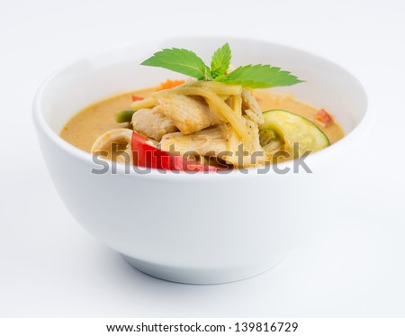 Bowl of Thai chicken red curry isolated on white background - stock photo