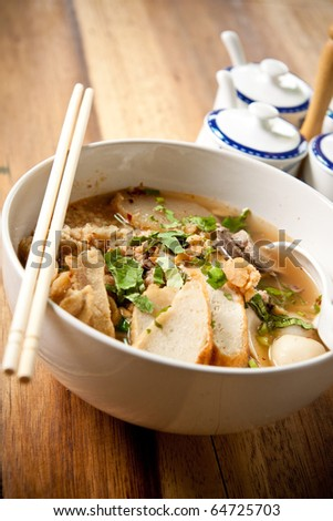 bowl of thai style beef noodle soup. - stock photo