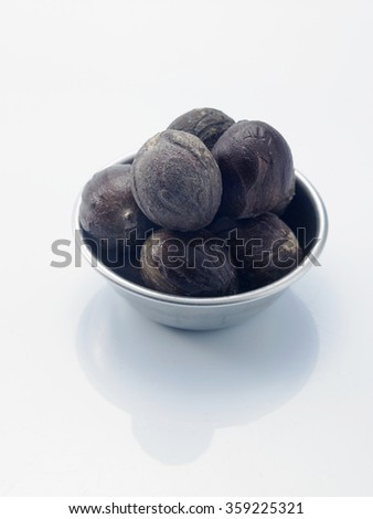 bowl of the nutmeg on the white background - stock photo