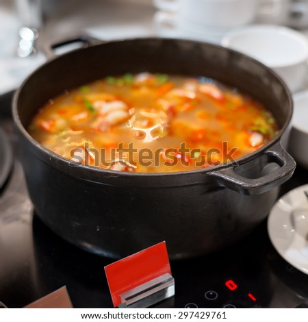 Bowl of Tom yum goong - Thai popular food - and favorite dishes hot and sour soup of thailand
