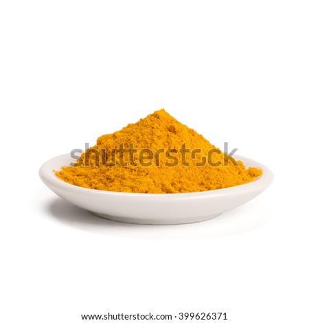 Bowl of turmeric powder - stock photo