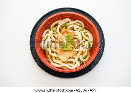 Bowl of udon noodles with spicy chicken isolated on white background - stock photo