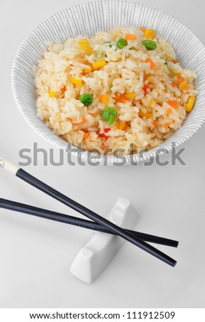 bowl of vegetable fried rice and chopstick. chinese cuisine - stock photo