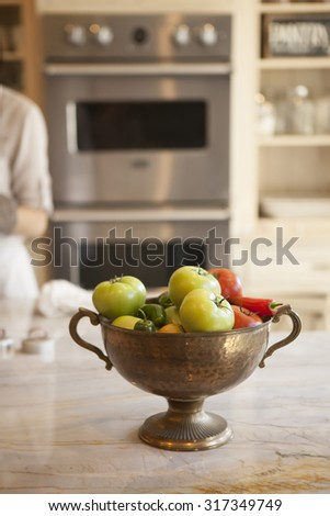 bowl of vegetables in a modern kitchen - stock photo