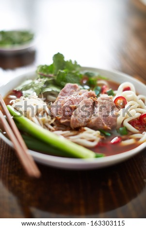 bowl of vietnamese pho in natural light - stock photo