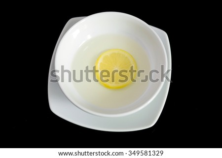 Bowl of water with lemon