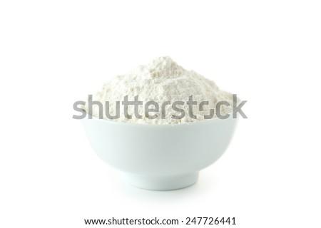 Bowl of wheat flour isolated on white - stock photo
