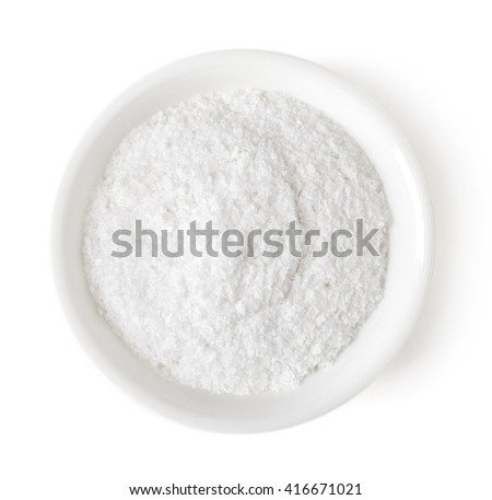 Bowl of white table salt isolated on white background, top view - stock photo
