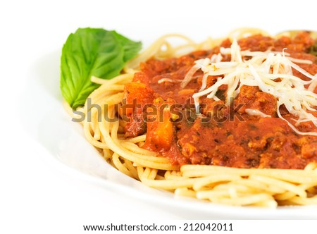 Bowl of whole wheat spaghetti and sauce: ground turkey, fresh basil, tomato sauce, bell peppers, onions, mushrooms, garlic, olive oil and italian seasonings.  - stock photo
