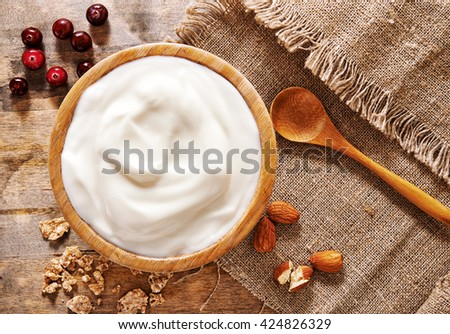 bowl of yogurt, berries and nuts. top view - stock photo