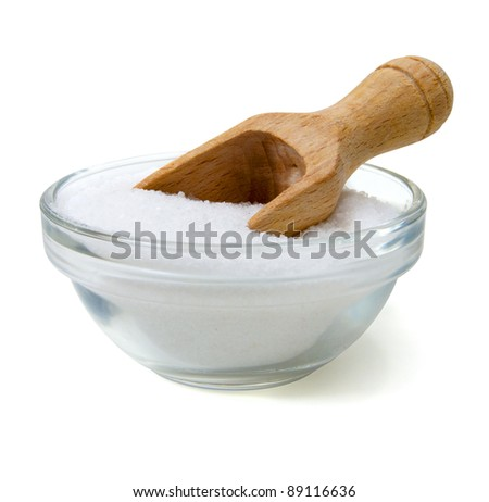 bowl salt with wooden shovel isolated on white - stock photo
