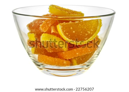 bowl with a fruit jellies in form citrus lobules in orange tones