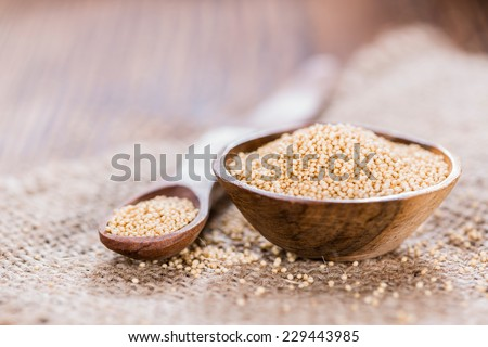 Bowl with Amaranth on wooden background (close-up shot) - stock photo
