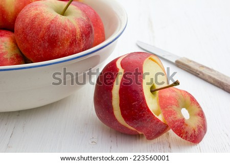 Bowl with apples on white table/fruits/apples - stock photo