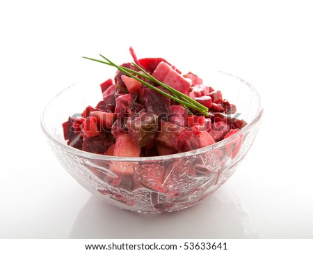 Bowl with beet salad isolated on white background