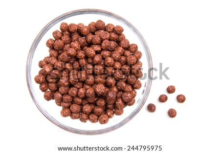 Bowl with chocolate cereal on white background top view