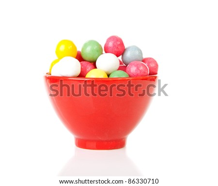 bowl with colorful gumballs over white background - stock photo