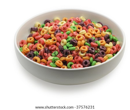 Bowl with colorful round cereal, seen from an angle, isolated on white background. Saved with clipping path