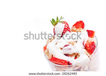 bowl with corn flakes and strawberry served on glass