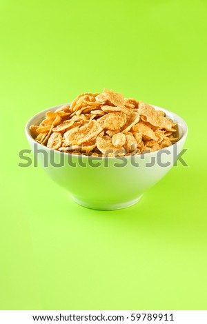 bowl with cornflakes on the colorful background - stock photo