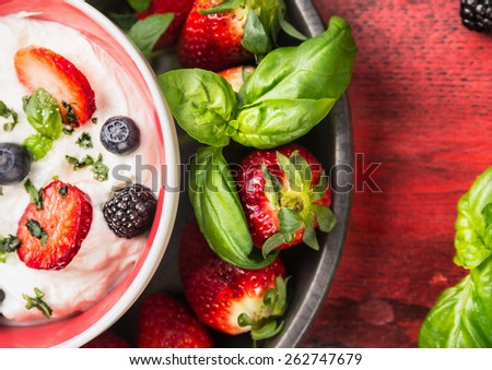 Bowl with cottage cheese,  blackberries, blueberries, strawberries and basil ,top view close up - stock photo