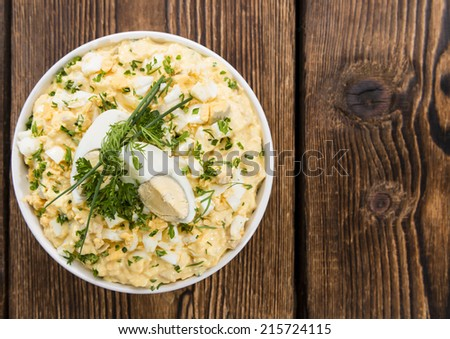 Bowl with Egg Salad on dark wooden background - stock photo