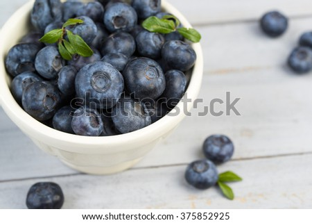 Bowl with fresh blueberries, closeup - stock photo