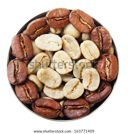 Bowl with green and roasted coffee beans isolated on white. - stock photo