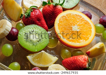 bowl with ice and juicy fruit - stock photo