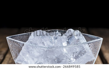 Bowl with Ice Cubes (on dark wooden background) - stock photo