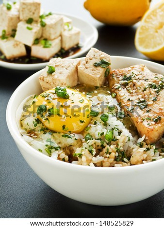 Bowl with jasmine rice, raw egg, sturgeon and vegetables. Shallow dof.  - stock photo