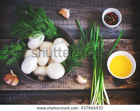 bowl with mushrooms, herbs and spices on an old background, tinted - stock photo