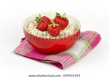 bowl with oatmeal and fresh strawberries - stock photo