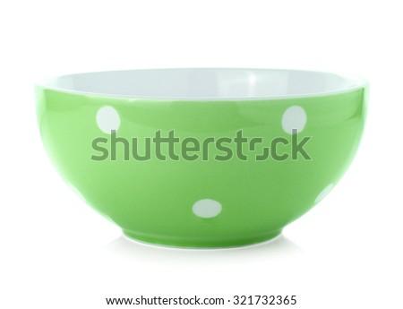 bowl with polka dots on white - stock photo