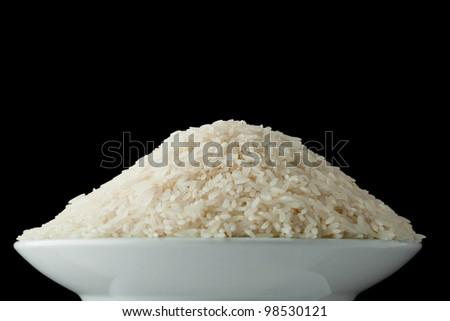 Bowl with raw white rice - stock photo
