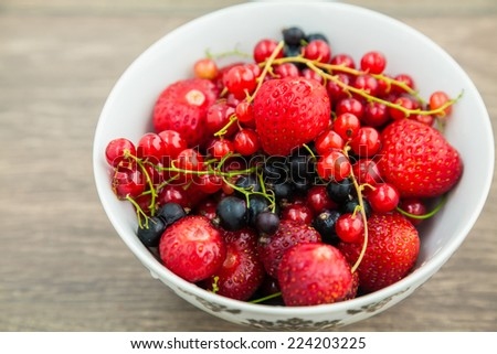 bowl with strawberries, blackberry and red currant - stock photo