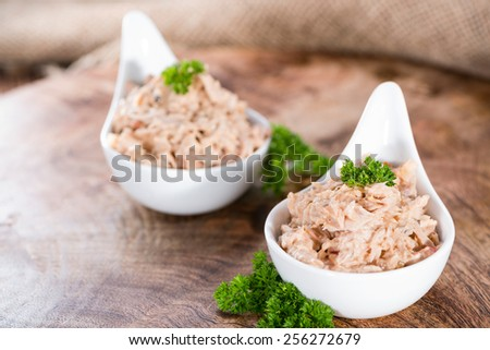 Bowl with Tuna salad on dark rustic wooden background - stock photo