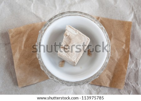 Bowl with yeast - stock photo