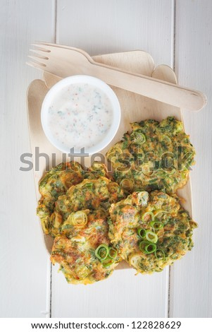 Bowl with zucchini fritters. - stock photo