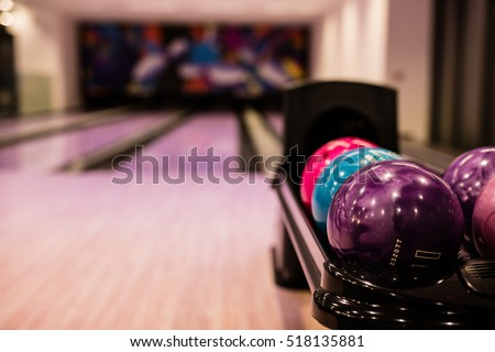 Bowling balls and wooden lane in bowling hall